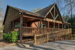 Nestled in the a wooded area, not far from a quiet cove on Lake Lure, is The Bear`s Den.