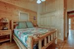 On the main level is a king bed suite with adoining private bath and sliding glass door to the porch.