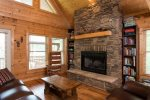 The focal point of the living area is the beautiful stone wood-burning fireplace.