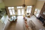 Here is the view of the living and dining areas from the stairs. The windows and French doors are striking.