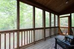 The screened deck is a perfect spot to relax.