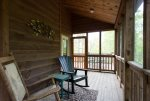 A door leads to the open sun part of the deck and a 4-person dining set.