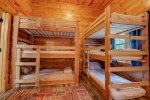 On the lower level are 2 bunk bed sets each with 3 twin beds.