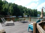 The boat house deck is a great place for sun, relaxation, meals, and for watching the lake activity.