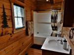 There is also a full bath on this level with a single vanity and bathtub/shower combination.