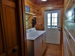 The laundry room has a full-size washer and dryer as well as access to the outdoors.