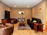 On the lower level is a family room with comfortable furniture, TV, and air hockey table.