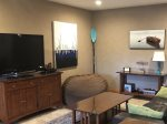 The lower level family room features upscale comfort.