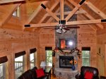The wood beams and architectural details of this great room draw your attention upward.