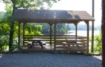 Enjoy a family picnic by the lake underneath the covered area.