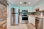 The kitchen includes an electric stove, oven, fridge, freezer, microwave, and dishwasher