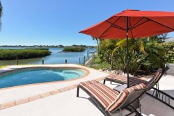 It`s Five O`Clock Somewhere!!  Here in this Stunning Waterfront Pool Home!