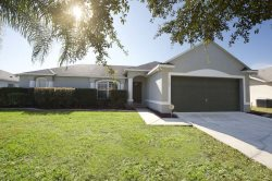 Relax poolside overlooking a Florida conservation area and small lake at this lovely villa in a gated community!