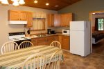 Kitchen is equipped with an electric range, washer and dryer combo, drip coffee pot, toaster, microwave and full size fridge.