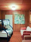 Bunkhouse with bunk bed and another queen bed