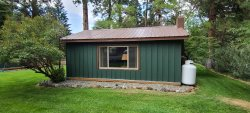 Knotty pine cabin walking distance to River, lake and activities.