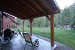 Great covered deck to sit and enjoy the sounds of the river.