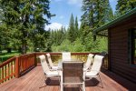 Large deck to sit out and enjoy views of the pond on the property.