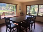 Dining room off of the kitchen with large windows overlooking the pond and the deck.