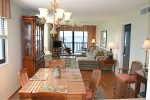Dining / Living Rooms to Riverfront Glass Enclosed Screened Patio