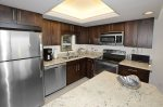 Kitchen With Granite Counter Tops & Stainless Steel Appliances