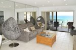Living Room With Oceanfront Balcony Access
