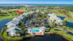 Lakeside Community With Pool in Foreground & 5575 Marked Red Arrow