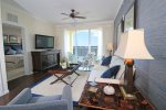 Nicely furnished comfortable Living Area with wide screen TV, & direct access to Balcony waterfront.