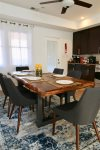 Live edge wood table adds an air of rustic elegance to the modern space