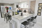 Kitchen island is great for unwinding together, snagging a meal, or getting some work done