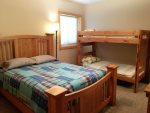Lower level bedroom 4 with queen bed, twin bunks