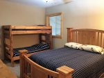 Lower level bedroom 5 with queen bed, twin bunks
