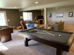 Lower level family room with foosball, pool/ping pong, TV