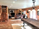Lower level family room, heated floors, TV, Fireplace, Pool Table