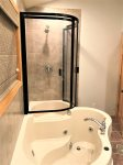 Upper level bathroom with shower and jacuzzi tub