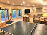 Lower level Family Room with TV, fireplace, Ping Pong Table