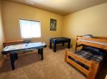 Lower level Bedroom 5 with air hockey, foosball, twin bunks