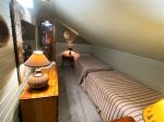 Lower level Family Room with TV, poker table, Pellet Stove