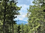 Master bedroom with King bed, TV, attached bathroom, deck access