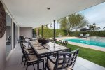 Expansive Covered Patio with Seating and Outdoor Kitchen