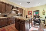 Kitchen is Well Equipped and Features Center Island & Breakfast Table