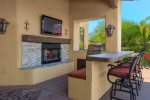 Outside Kitchen with Gas Grill, Fireplace, Sink and TV