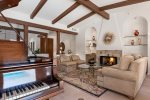 Grand Piano & Gas Fireplace in Formal Living Room Make It A Great Place For Entertaining