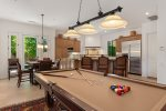 Family Room Features Leather Seating, 55 Inch TV, Wetbar With Wine Refrigerator and Billiards Table