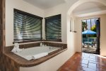 En-Suite Master Bathroom Has Tub & Walk-In Shower With Mountain View