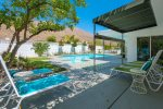 West Facing Backyard with Pool, Spa, Six Lounge Chairs And Retractable Awning