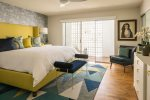 Blue Bedroom Features King Bed, 49 Inch HD TV And Access to Patios Protected With Vintage Brise Soleil Blocks