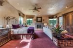En suite Master bath includes walk-in shower with floor to ceiling stone, spa bathtub, oversized double sink vanity