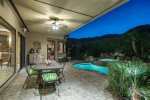 Pebble tech spa with spillover waterfall into pool