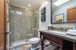 Guest Bath Features Walk-In Glass And Granite Shower